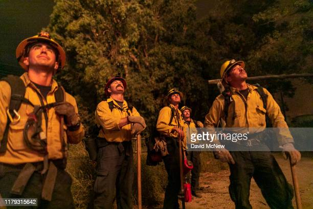 Firefighters watch the progress of a backfire they are setting at the Maria Fire which exploded to 8000 acres on its first night on November 1 2019...