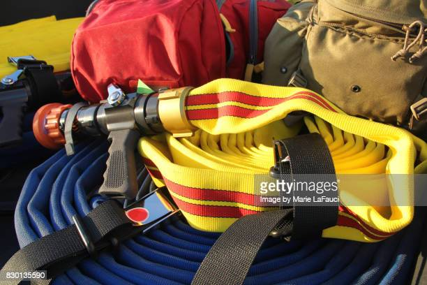 firefighter's water hose and equipment - fauci stock pictures, royalty-free photos & images