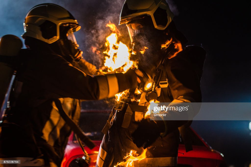 Firefighters with burning suit : Stock Photo