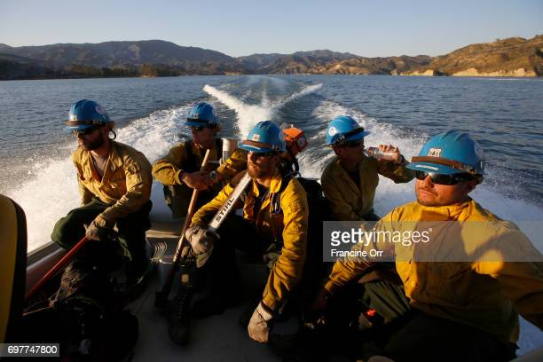 Firefighters with the USFS Sierra Hotshots Freeman Wilfong Cole Sjostrom Dillon Scardino Ian Smith and Gabriel Dubai come off the fire line and get a...