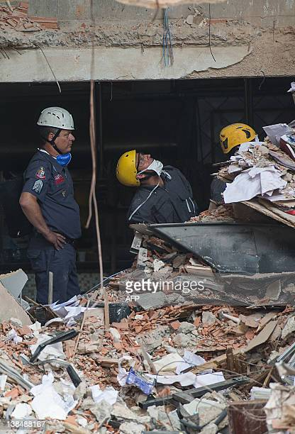 Firefighters work amid rubble of a 14-story building that collapsed in downtown Sao Bernardo do Campo, about 25km south of Sao Paulo, Brazil, on...