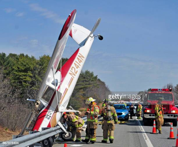 Firefighters work around a crash landed Cessna on Tuesday April 11 2017 in the south bound breakdown lane of Interstate 295 in Bowdoinham