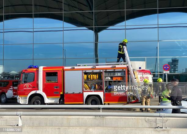 Firefighters work at AlicanteElche airport on January 15 2020 in Alicante after a fire erupted in the terminal