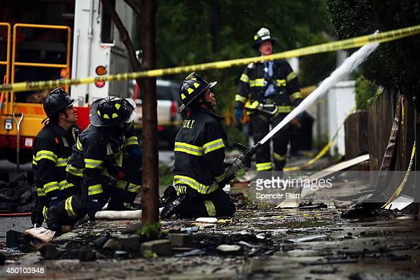 Firefighters Work At The Scene Of A Fivealarm Fire That Burned For Several Hours On June