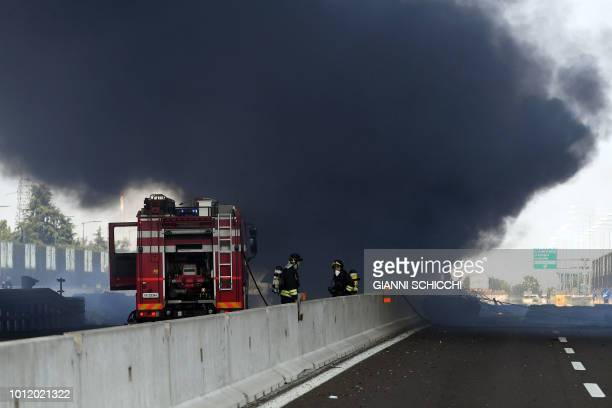 TOPSHOT Firefighters work at the scene where a tanker truck exploded on a motorway just outside Bologna northern Italy on August 6 2018 A tanker...