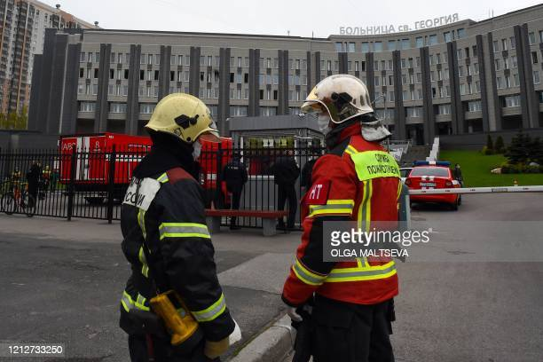 Firefighters work at the site of a fire at the Saint George hospital in Saint Petersburg on May 12 2020 A fire at a hospital in Russia's second city...