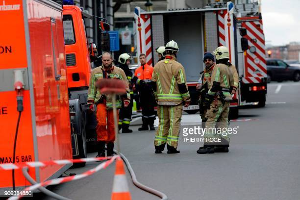 Firefighters work during an anthrax alert at the cabinet of State Secretary for Asylum Policy Migration and Administrative Simplification Theo...