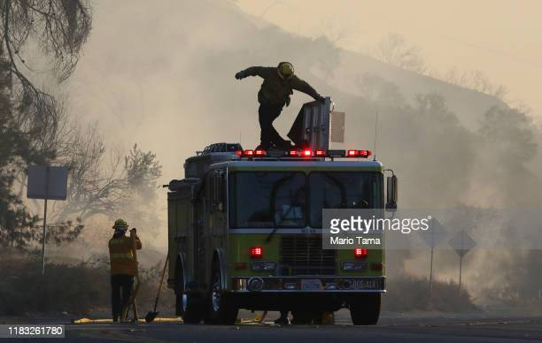 Firefighters work during the Tick Fire on October 24 2019 in Canyon Country California The fire has burned at least 3700 acres thus far