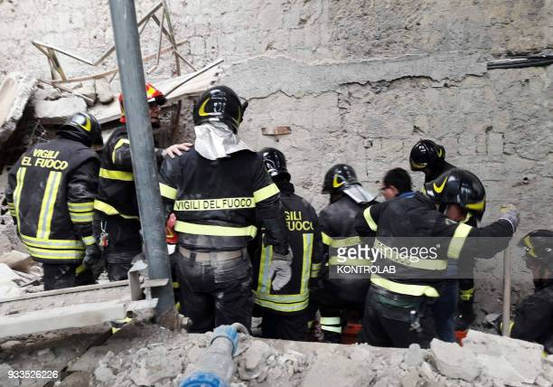Firefighters work looking for wounded in the site of a collapsed wall inside the abandoned monastery of the church of San Giovanni Maggiore in...