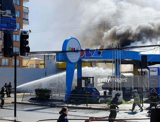 Firefighters work on a petrol station that burns in Vina del Mar 100km west of Santiago on August 13 2013 The explosion of a gas tanker Tuesday set...