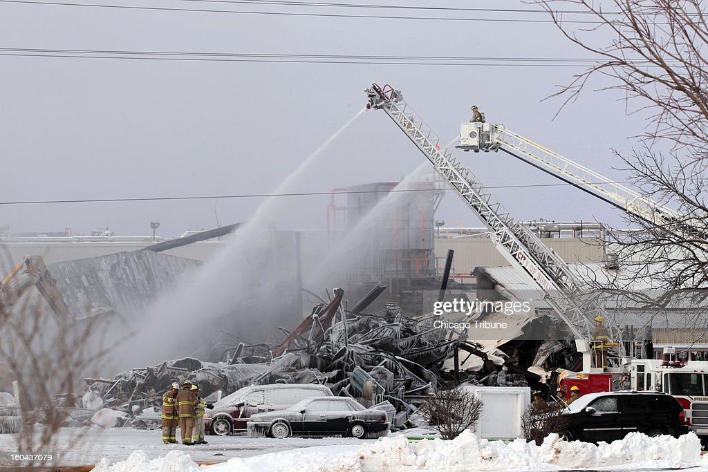 Firefighters work on putting out a fire at the Echo Lake Farms Produce Company in Burlington, Wisconsin, Thursday, January 31, 2013.