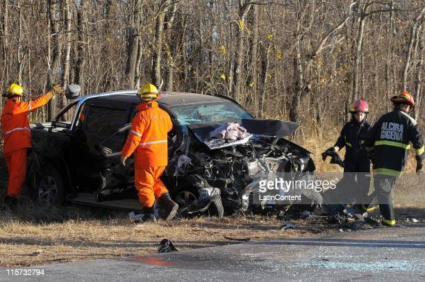 Firefighters work on the wreckage of a Toyota Hilux of Napoli's Argentine soccer player Hugo Campagnaro which crashed with another car in the route...
