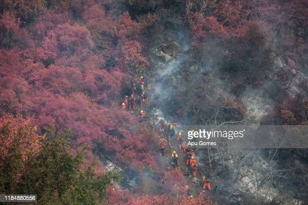Firefighters work the Cave Fire at Los Padres National Forest on November 26 2019 in Santa Barbara California Officials say the fire is now 10...