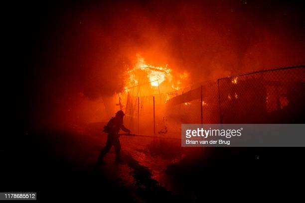 Firefighters work the Getty fire as it burns homes along Tigertail Rd in the Brentwood Heights neighborhood of Los Angeles Calif on Oct 28 2019