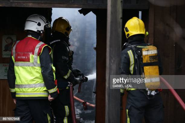 Firefighters work to control a fire at London Zoo in London on December 23 2017 An aardvark died and four meerkats were missing Saturday following a...