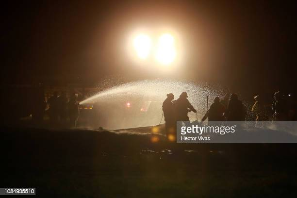 Firefighters work to control the fire after an explosion in a pipeline belonging to Mexican oil company PEMEX on January 19 2019 in Tlahuelilpan...