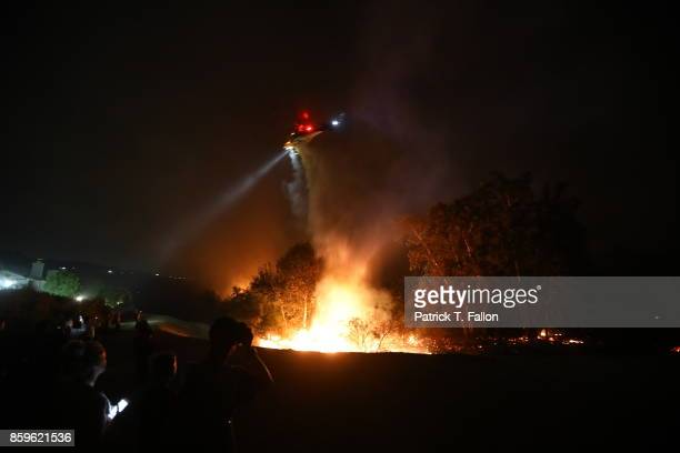 Firefighters work to control the spread of a wildfire on October 9 2017 in Anaheim Hills California The new fire dubbed Canyon Fire 2 started near...