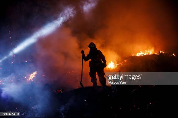 Firefighters work to control the western side of Grant Park as brushfire engulf most of the vegetation on the hill on December 5 2017 in Ventura...