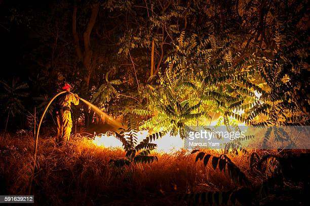 Firefighters work to defend structures on Lytle Creek Road in San Bernardino County Calif on Aug 17 2016
