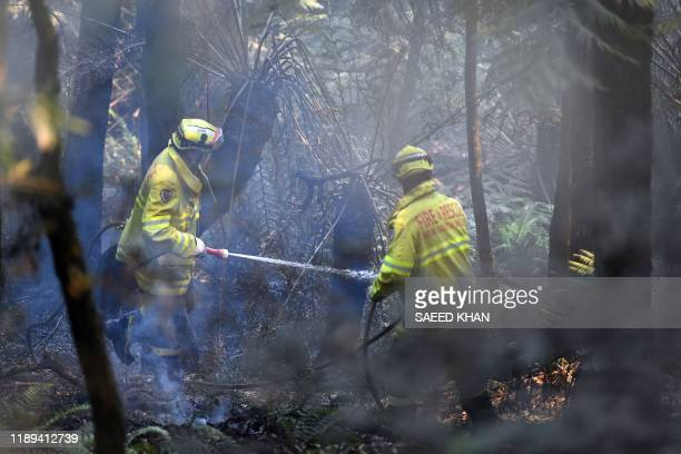 Firefighters work to extinguish a bushfire in Mount Weison in Blue Mountains some 120 kilometres northwest of Sydney on December 18 2019 Australia...