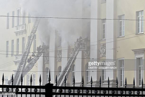 Firefighters work to extinguish a fire at a building of Russia's Defence Ministry in central Moscow on April 3 2016 / AFP / DMITRY SEREBRYAKOV