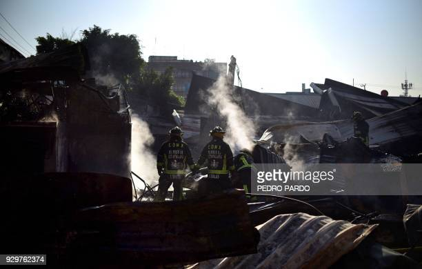 Firefighters work to extinguish a fire at Hidalgo market in Mexico City on March 9 2018 Mexico City woke up with news of four different fires acorss...