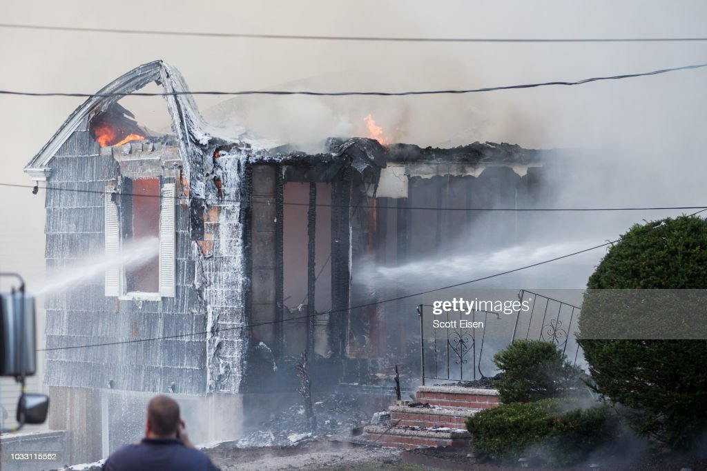 Firefighters work to extinguish a fire caused by over pressurized gas lines on September 13, 2018 in Lawrence, Massachusetts. Dozens of fires broke out in Lawrence, North Andover and Andover because of the gas lines.