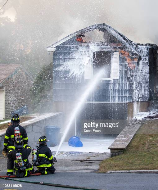 Firefighters work to extinguish a fire caused by over pressurized gas lines on September 13 2018 in Lawrence Massachusetts Dozens of fires broke out...