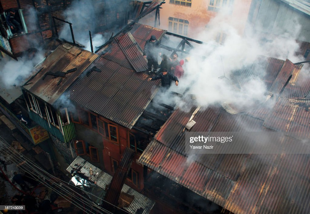 Firefighters work to extinguish a fire that gutted residential houses on November 07, 2013, in Srinagar the summer capital of Indian administered Kashmir, India. Several families were left homeless in Maharaja Bazar locality in uptown Srinagar and no injuries were reported.