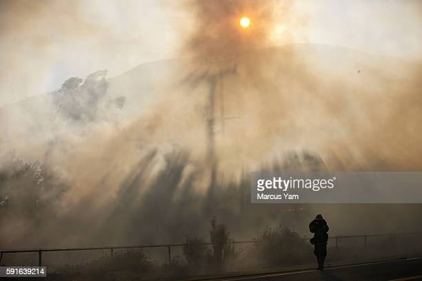 Firefighters work to extinguish flames on Cajon Blvd along the interstate 15 in San Bernardino County Calif on Aug 17 2016