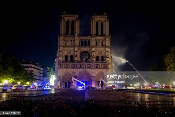Firefighters work to extinguish the fire outside famed NotreDame Cathedral on April 15 2019 in Paris France A fire broke out on Monday afternoon and...