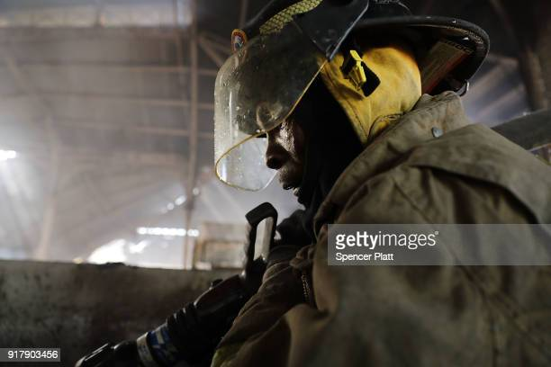 Firefighters work to put out a blaze at PortauPrince's historic Iron Market on February 13 2018 in PortauPrince Haiti Hundreds of locals vendors lost...