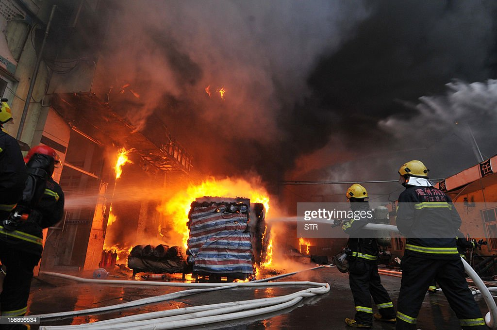 Firefighters work to put out a fire at a fur factory that contains six tanks of hazardous chemicals in Wenzhou, in eastern China's Zhejiang province. More than 350 firefighters were brought in to get the fire under control, while no deaths were reported yet. CHINA