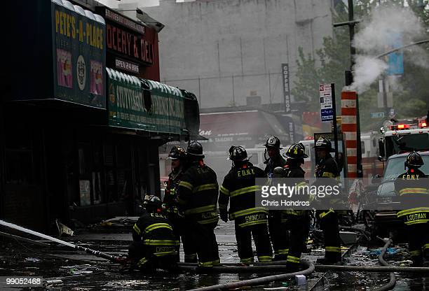 Firefighters work to put out the remainders of a threealarm fire that broke out at 502 East 14th Street across from Stuyvesant Town in lower...