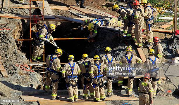 Firefighters work to recover body of a worker one of workers who became trapped in a trench March 14 2013 in Pacific Palisades More than 50...