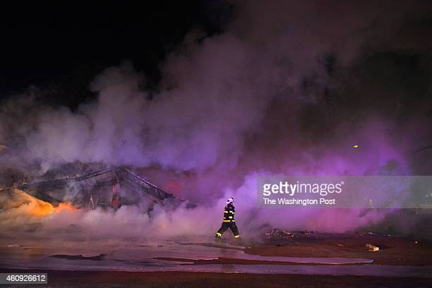 Firefighters worked to put out fires that spanned the town after an announcement that Ferguson police officer Darren Wilson will not be indicted in...