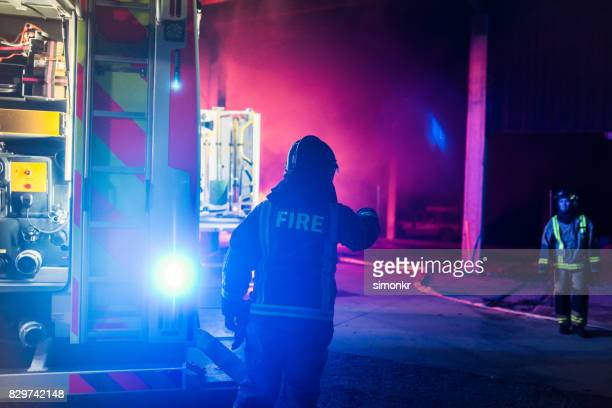 firefighters working - firetruck stock photos and pictures
