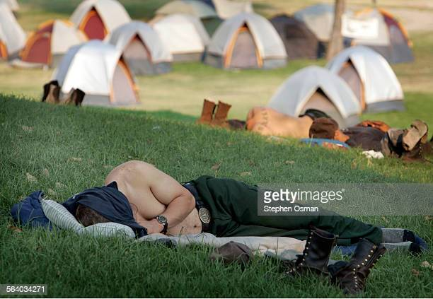 Firefighters working the Day fire north of Castaic on Wednesday September 13 take a much needed rest at their camp which is located at Castaic Lagoon...