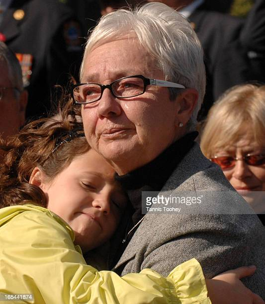 FirefightersOctober 1 2006Barb Aitcheson comforts and finds comfort in the embrace of her granddaughter Rachel Aitcheson as they attend the Ontario...