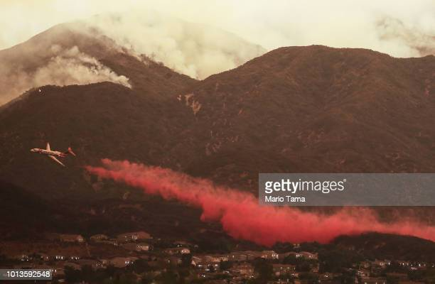 A firefighting airplane drops fire retardant ahead of the Holy Fire as it burns in Cleveland National Forest on August 8 2018 in Corona California...
