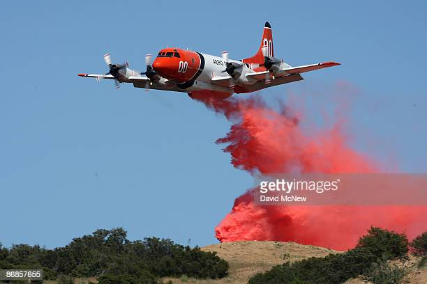 A firefighting airtanker drops Phoscheck fire retardant as firefighters try to stop the advance of the Jesusita fire on May 8 2009 near Santa Barbara...