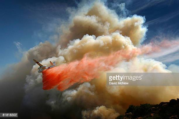 A firefighting airtanker drops PhosCheck fire retardant over the Gap fire as more than 1000 wildfires continue burning across about 680 square miles...