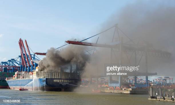 A firefighting boat fights a fire on the container ship 'CCNI Arauco' in HamburgGermany 01 September 2016 This afternoon a fire broke out on the...