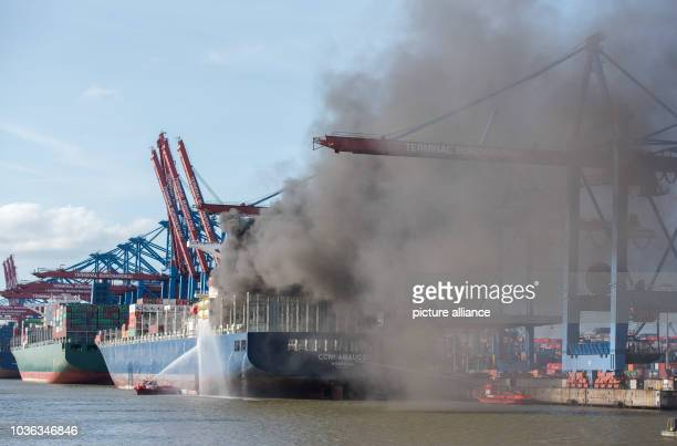 A firefighting boat fights a fire on the container ship 'CCNI Arauco' in Hamburg Germany 01 September 2016 This afternoon a fire broke out on the...