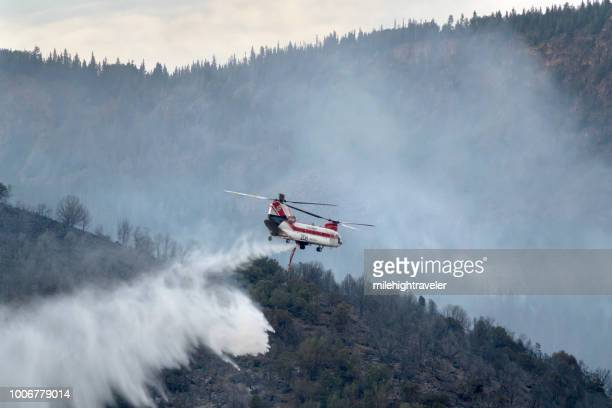 Firefighting chinook helicopter drops water Lake Christine forest fire Basalt Mountain Colorado Rocky Mountain smoke