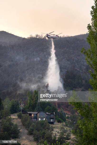 firefighting chinook helicopter drops water over home lake christine forest fire basalt mountain colorado rocky mountain smoke - basalt stock pictures, royalty-free photos & images