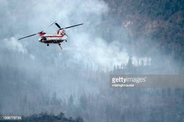 Firefighting chinook helicopter flies low smoke Lake Christine forest fire Basalt Mountain Colorado Rocky Mountain