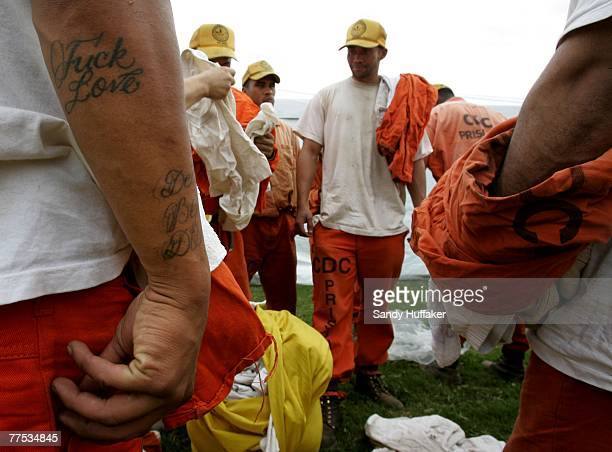Firefighting prisoners with the California Corrections Center receive fresh clothes after an overnight shift at a base camp October 27 2007 in...