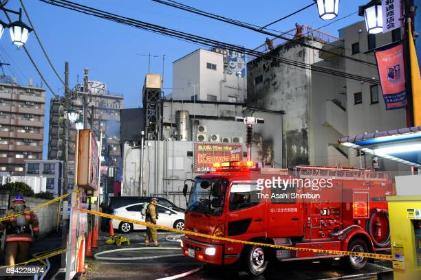 Firefighting vehicles surround a building where a sex service parlour is located on December 17 2017 in Saitama Japan 4 Four people were killed and...