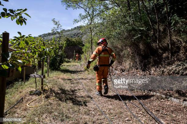 Firefights tackle a forest fire near forest from Pisa Italy on 25 September 2018 A huge fire took place in the Monte Serra the mount over the little...